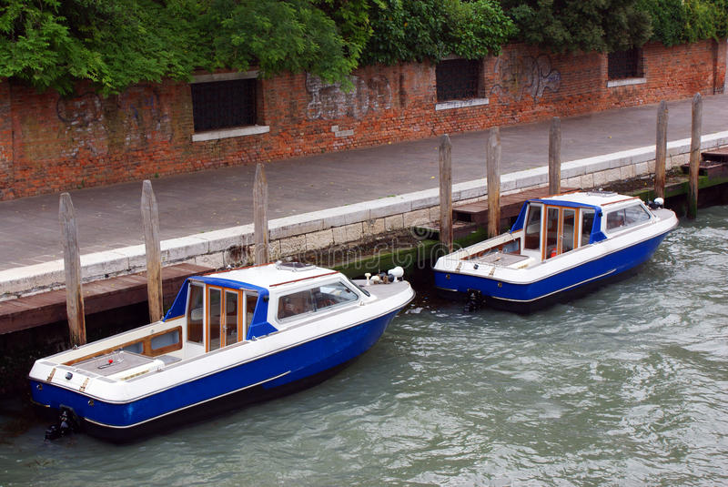 Two boats on channel stock images