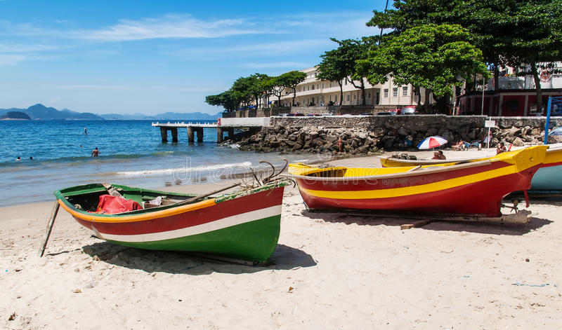 Two boats on the Copacabana beach and Fort of Copacabana in Rio de Janeiro. Brazil royalty free stock images