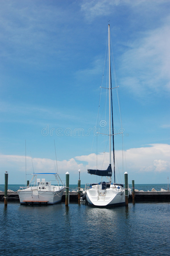 Two boats by dock stock photo