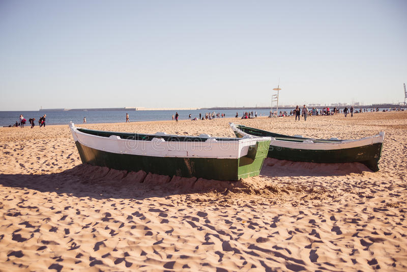 Two boats on the sand stock photography