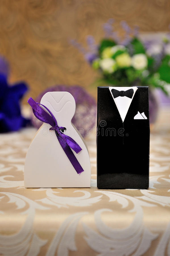 Two bonbonniere. With image of groome and bride stock photo