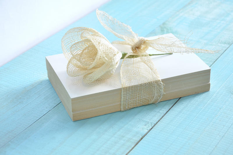 Two books tied with a raffia ribbon royalty free stock images