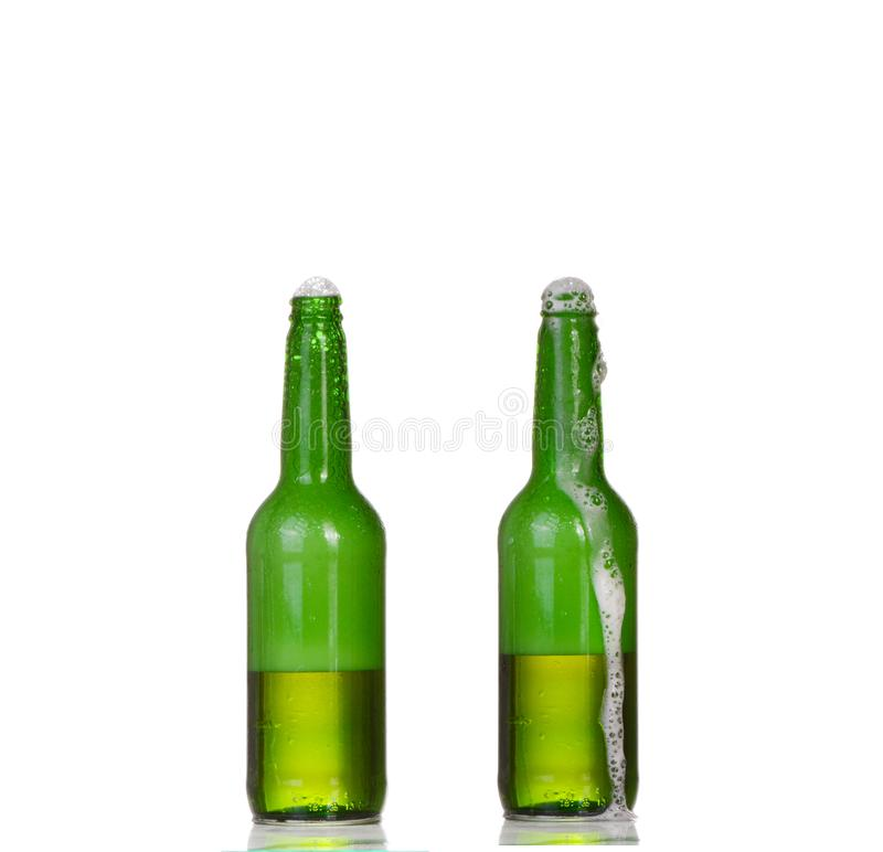 Two bottles of beer isolated on white royalty free stock photos