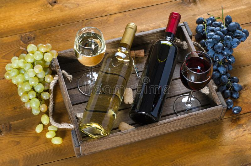 Two bottles with wine on a wooden background. royalty free stock photography