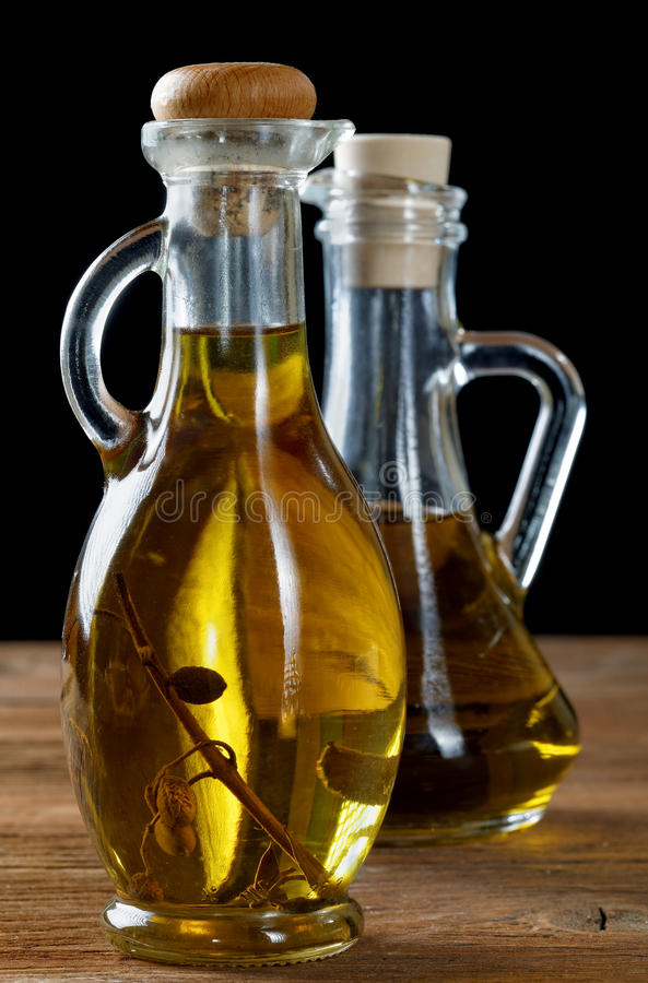 Two bottles of olive oil on table stock photos