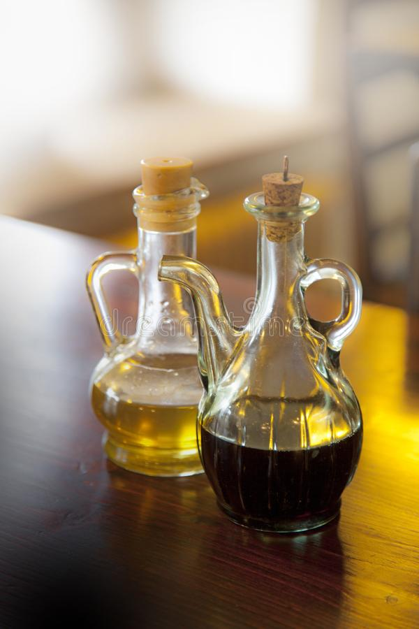 olive and pumpkin oil on a wooden table stock photography