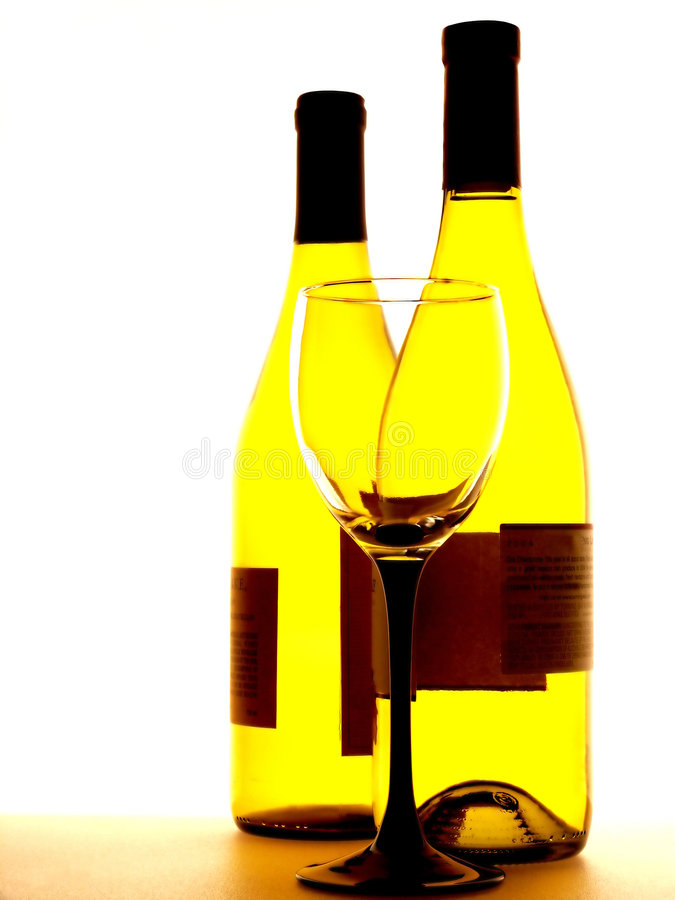 Two Bottles of Wine and a Glass royalty free stock photos