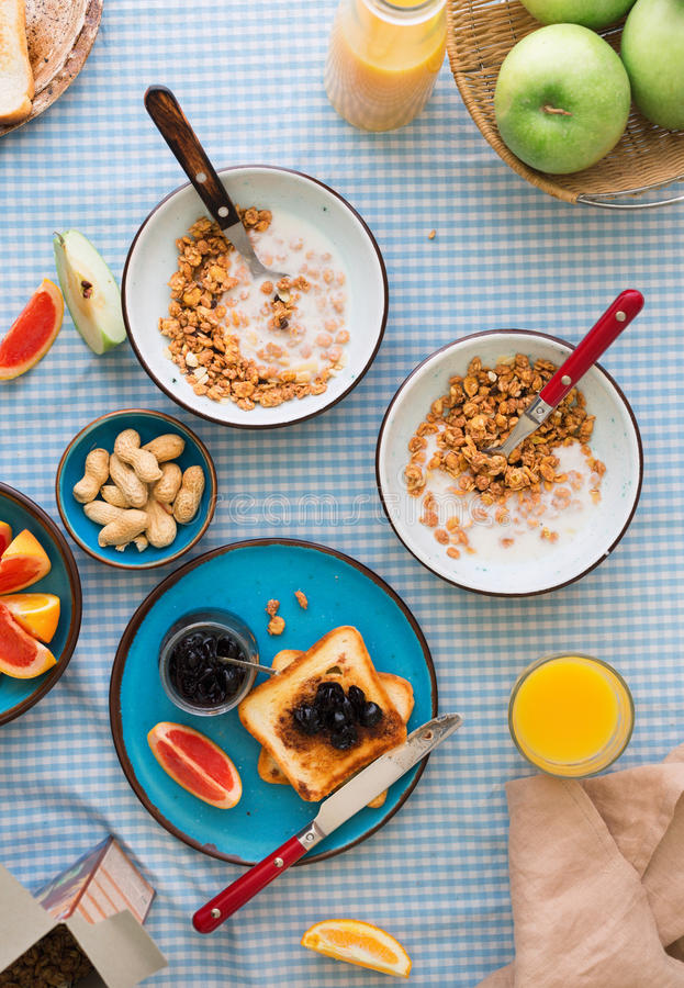 Two bowl of muesli with yogurt on table. Healthy breakfast stock images
