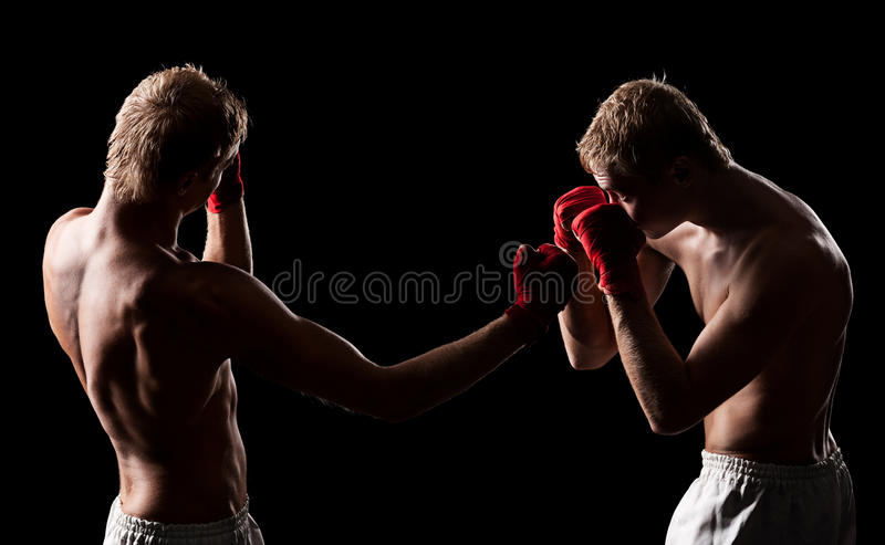Two boxers are fighting
