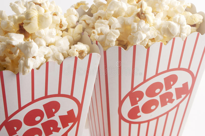 Two Boxes of Popcorn. Popcorn in a red and white striped popcorn box stock image