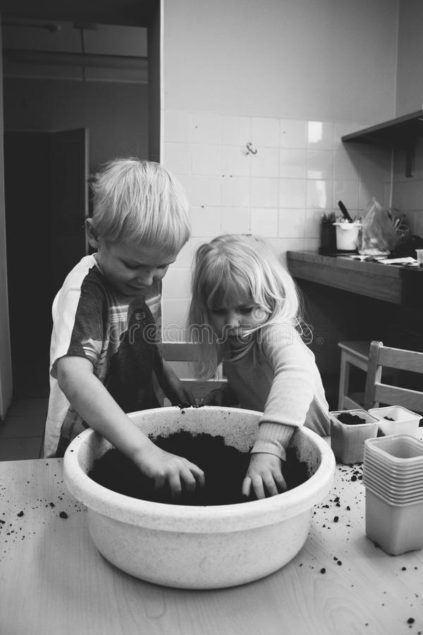 Two Boy and Girl Holding Mud royalty free stock image