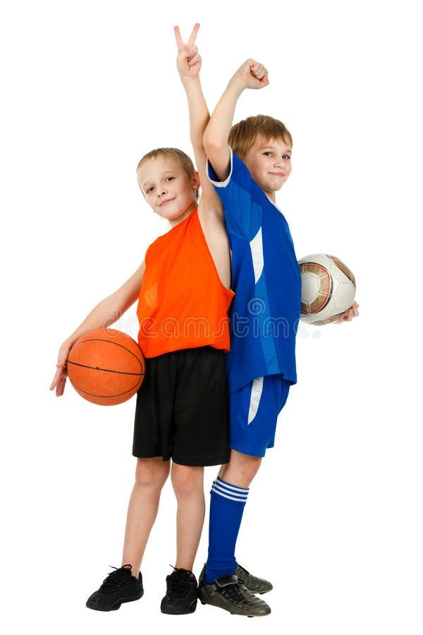 Two boys - basketball player and footballer royalty free stock photography