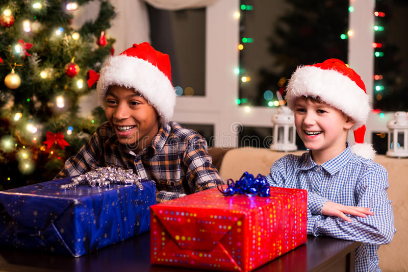 Two boys with Christmas presents. royalty free stock images