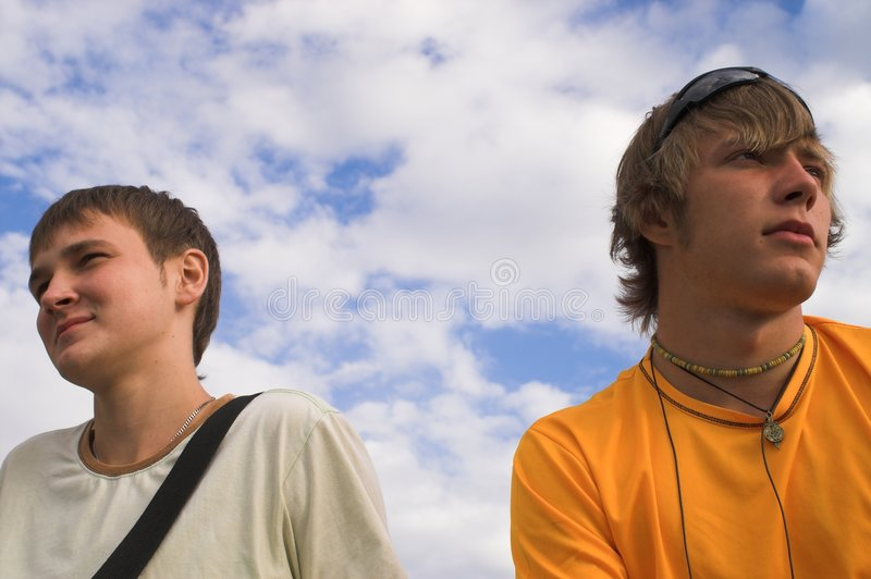 Two boys in the face of sky stock images