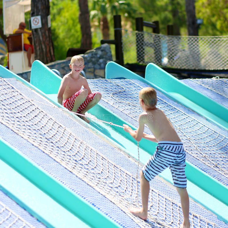 Two boys having fun at water park royalty free stock photos