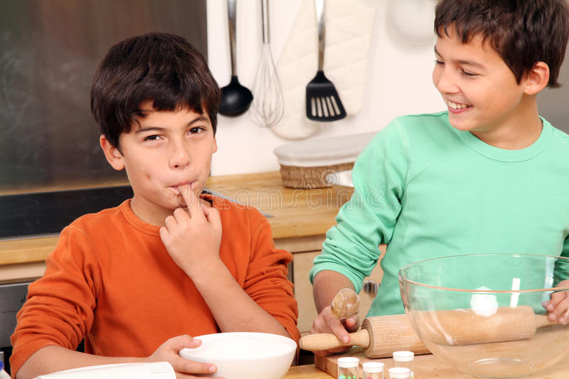 Two Boys in the kitchen royalty free stock images