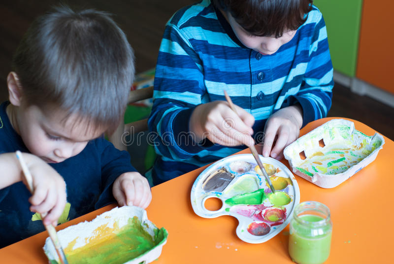 Two boys painting stock photos