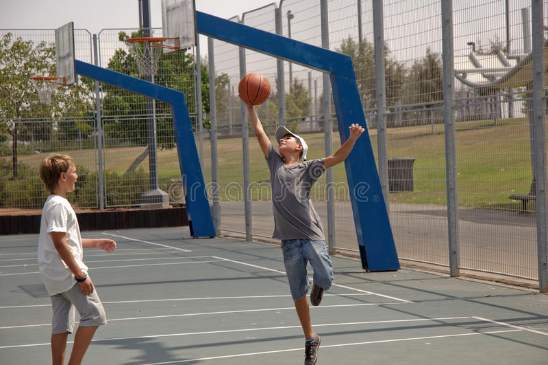 Two boys playing basketball . stock photo