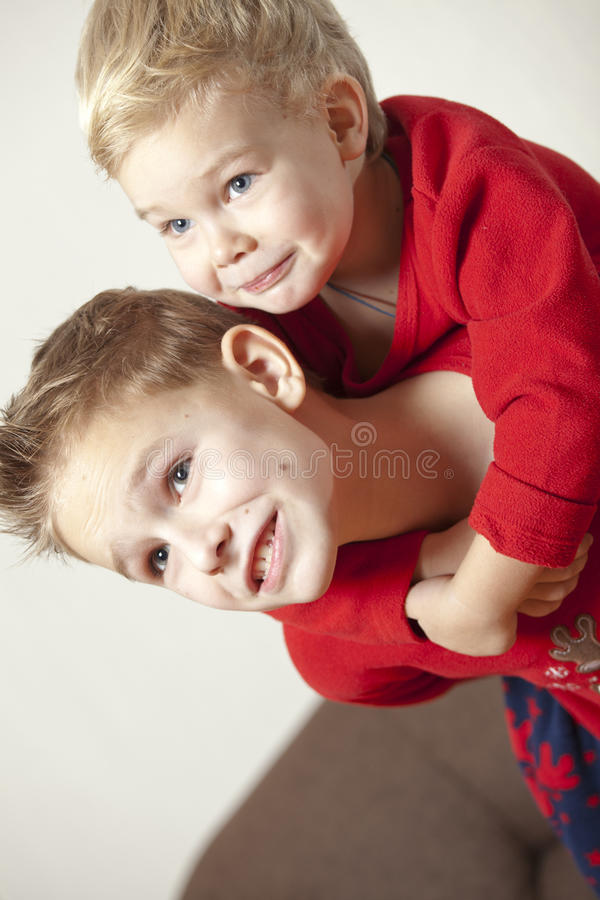 Download Two Boys Playing And Embracing Stock Photo - Image: 28575558