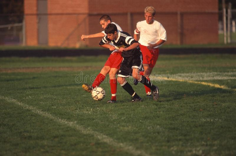 Two boys playing high school soccer royalty free stock photos