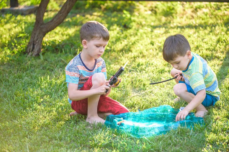 Two boys playing with a spinning top kid toy. Popular children game tournament royalty free stock images