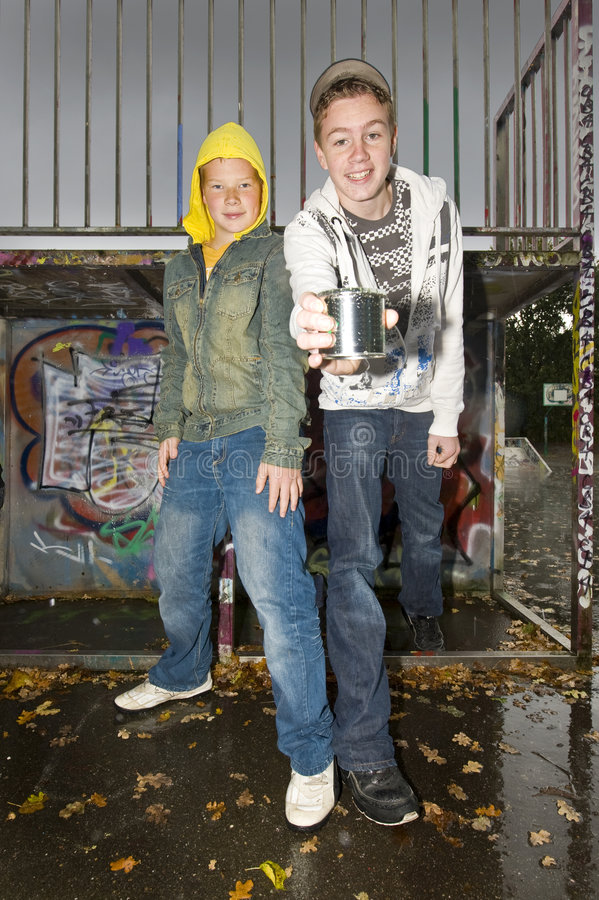 Two boys showing a can royalty free stock photos