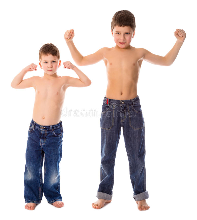 Two boys showing his muscles. Isolated on white stock images