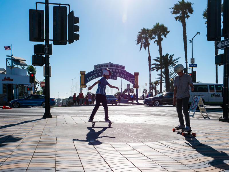 Two Boys skateboarding In Santa Monica stock photography
