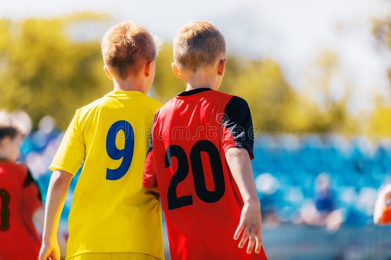 Two Boys Soccer Players in Colourful Jersey Shirts. Kids Children Compete in Sports Competition. Defensive Organization in Junior Youth Football Team stock photos