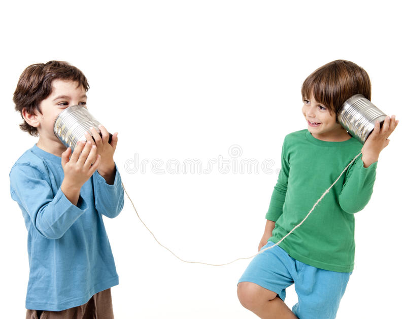 Two boys talking on a tin can phone. Isolated on white stock image