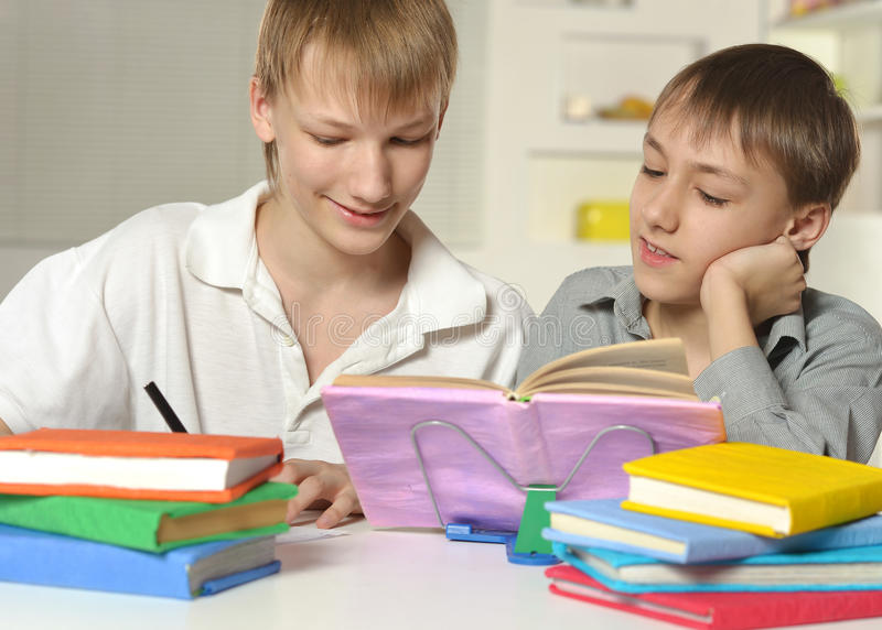 Two boys with their homework royalty free stock image