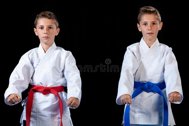 Two boys training karate kata exercises at test qualification.  stock photo