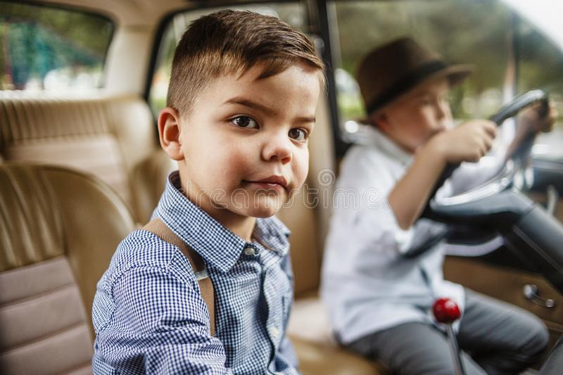 Two boys in vintage clothes stock photos