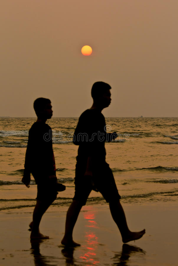 Download Two boys walking in sunset stock photo. Image of family - 30035414