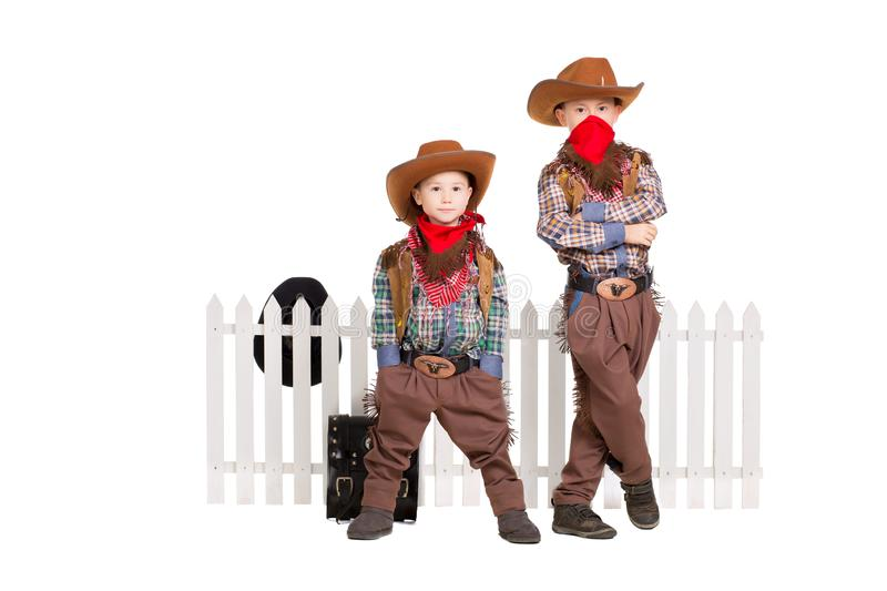 Two boys wearing cowboy costumes royalty free stock photos