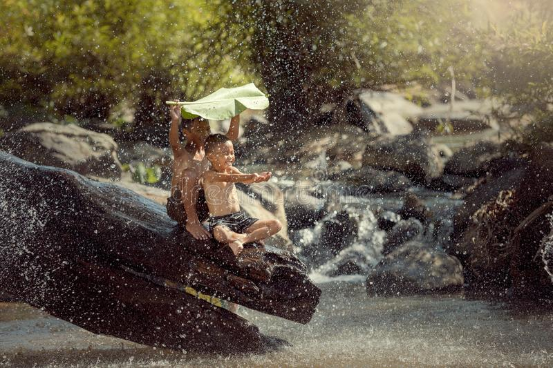 The two boys were enjoying fun playing with water royalty free stock photography