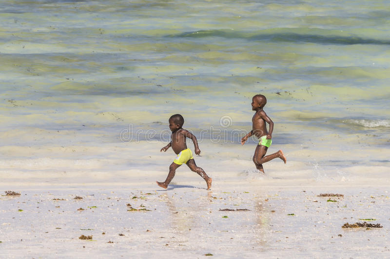 Two boys on Zanzibar beach. Two Little boys playing on tropical beach in Kiwenga Village and Kiwengwa Beach resort on Zanzibar Island. Tanzania , Africa royalty free stock photos