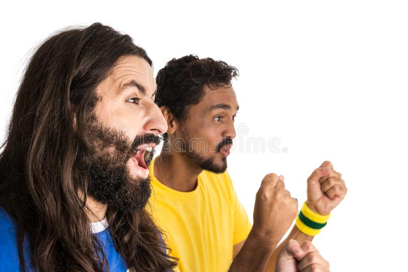 Two brazilian friends celebrating on soccer / football match on stock images