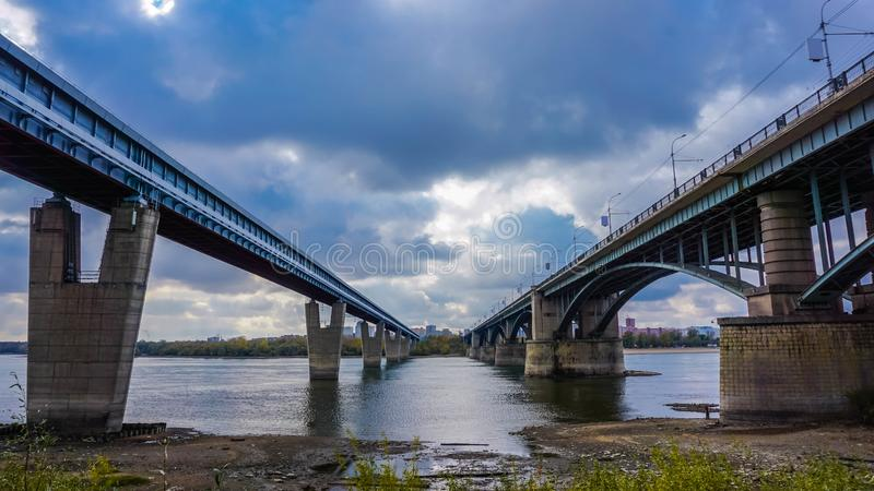 Two bridges over the river. Novosibirsk city, Russia. Ob river royalty free stock image