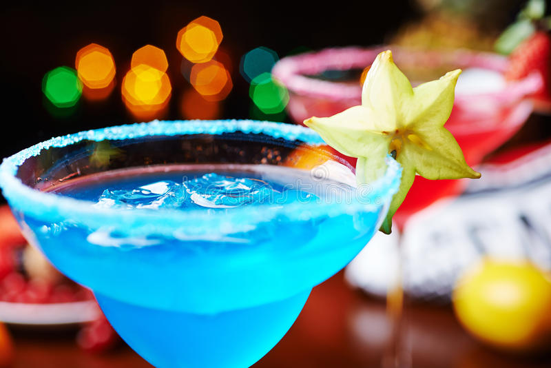 Two bright refreshing cocktails: blue margarita and strawberry daiquiri. A mix of the two bright refreshing cocktails: blue margarita and strawberry daiquiri on royalty free stock images