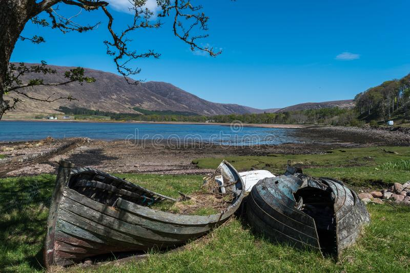 Two Broken boats near a lake royalty free stock images