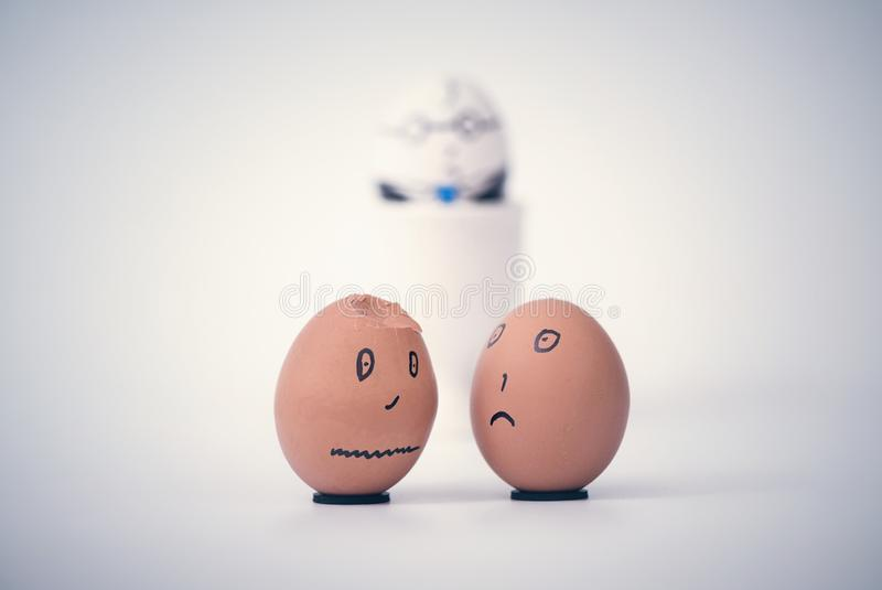 Two broken dark eggs employee in the form of human head complain to each other. Boss egg on the background royalty free stock photos