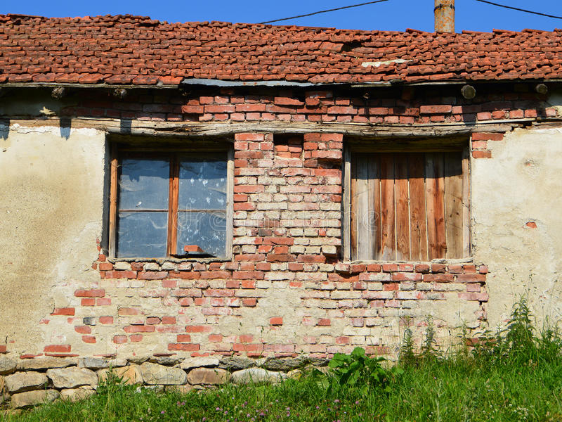 Two broken windows of ruined cottage royalty free stock photos