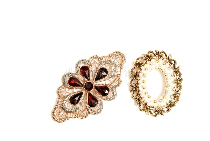 Two brooch. Two brooch on white background with pearls and gems in gold stock image