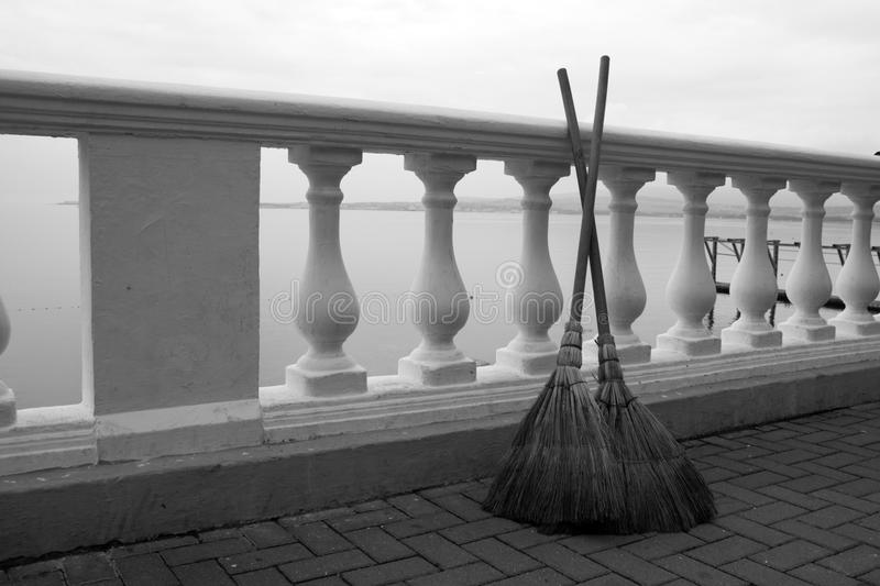 Two brooms on the seafront stock photos