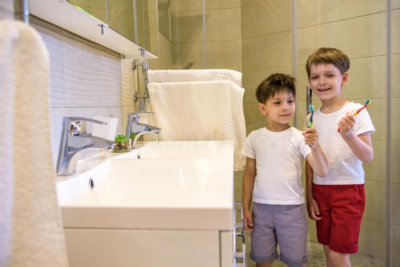 Two brothers brush my teeth in the bathroom.The beginning of a new day royalty free stock images