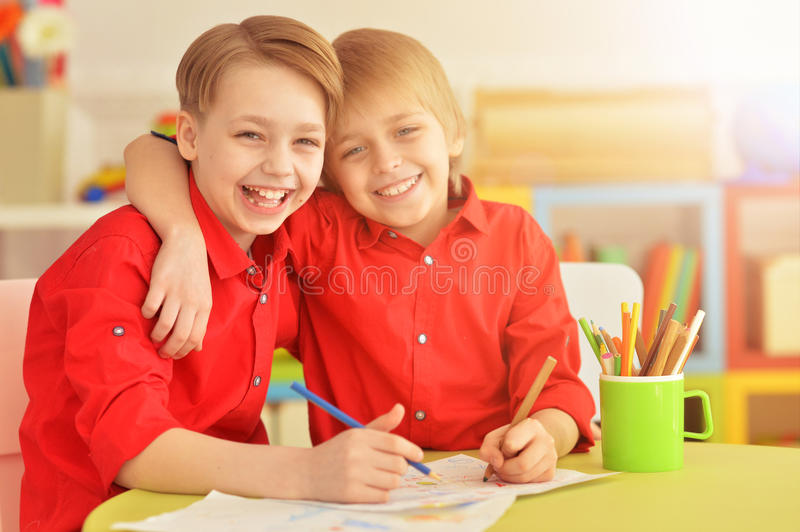 Two brothers draws with pencils royalty free stock photo