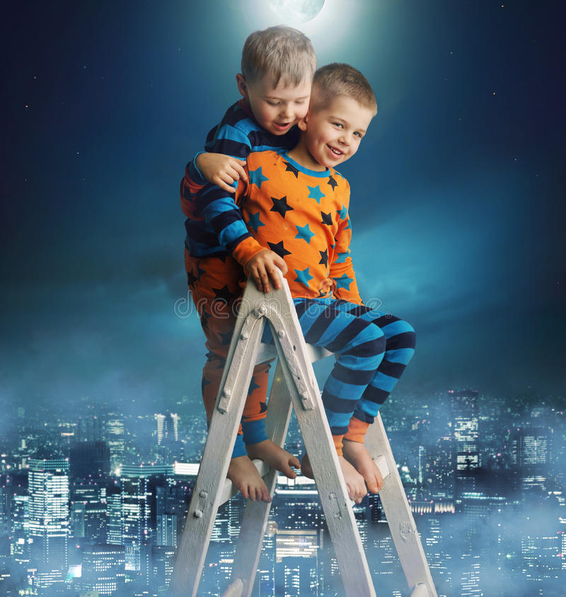 Two brothers on the magic ladder. Two little brothers on the magic ladder royalty free stock image