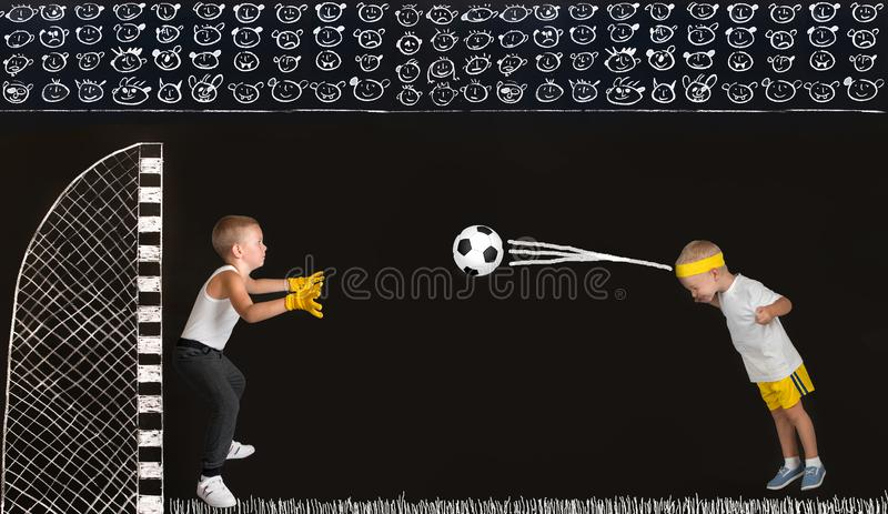 Two brothers play football.Drawings in chalk on the wall. stock images