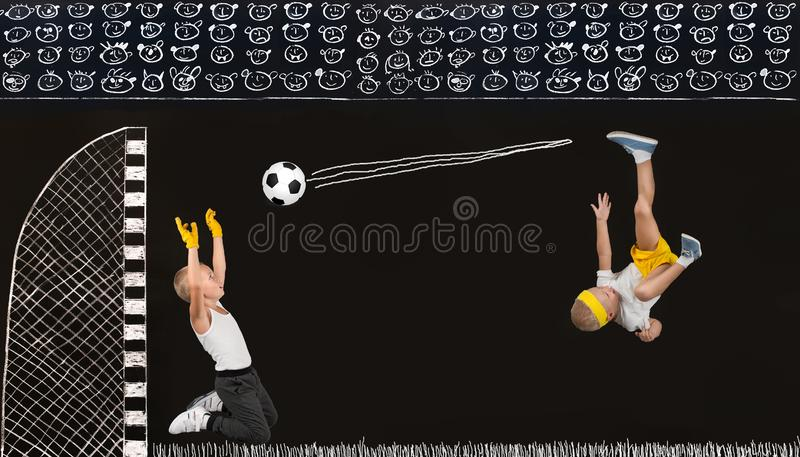 Two brothers play football.Drawings in chalk on the wall. Drawings in chalk on the wall.Two brothers play football stock image